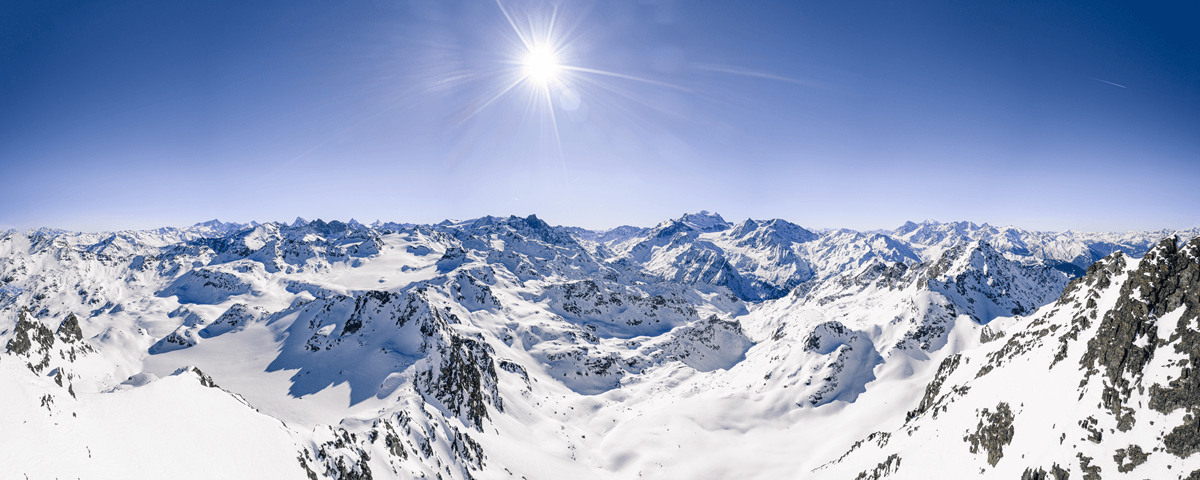 beautiful-panoramic-shot-snow-covered-mountain-ranges-clear-blue-sunny-sky